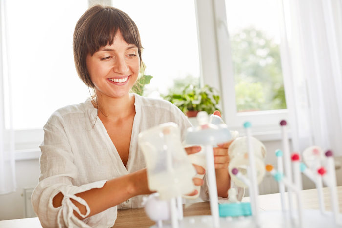 mom washing bottles formula feeding.