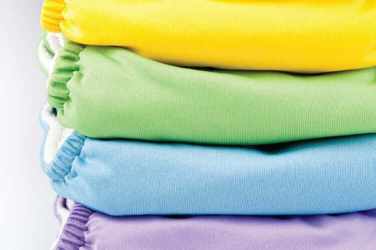 stack of colorful baby cloth diapers