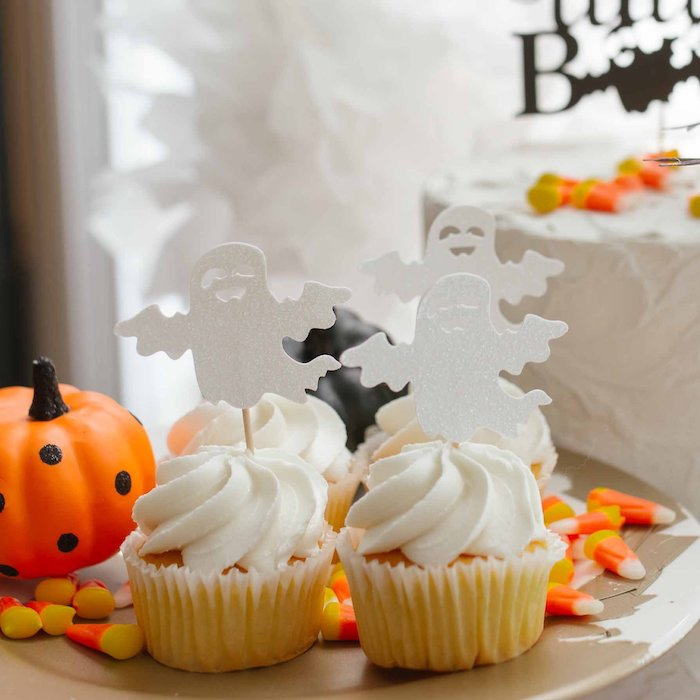 halloween cupcakes with ghosts for spooky fall baby shower theme