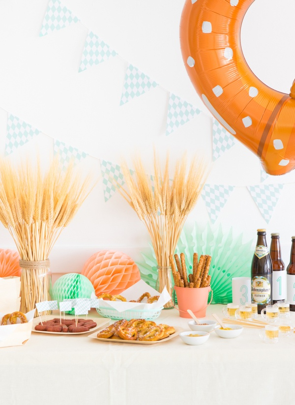 Oktoberfest baby shower idea- table set with wheat, pretzels, and beer