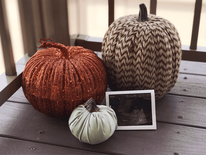 festive pumpkin halloween pregnancy announcement with ultrasound