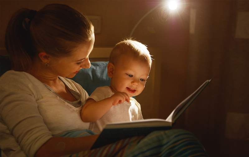 mom reading to baby for bedtime