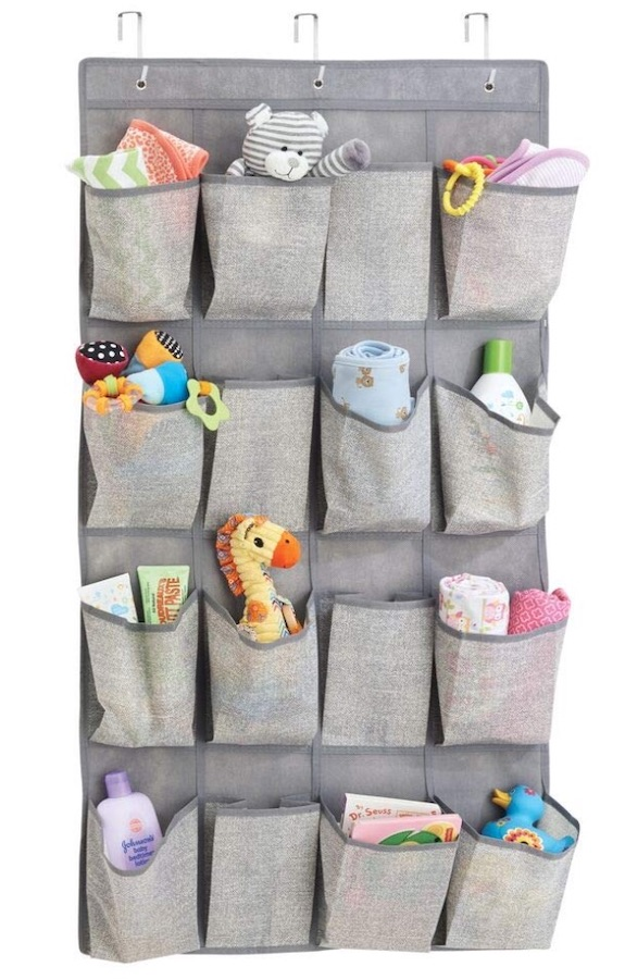 small nursery ideas - closet door organizer filled with baby things