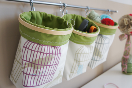 small nursery ideas - storage bags on wall
