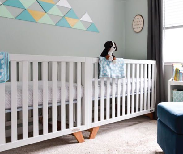 white cribs in nursery