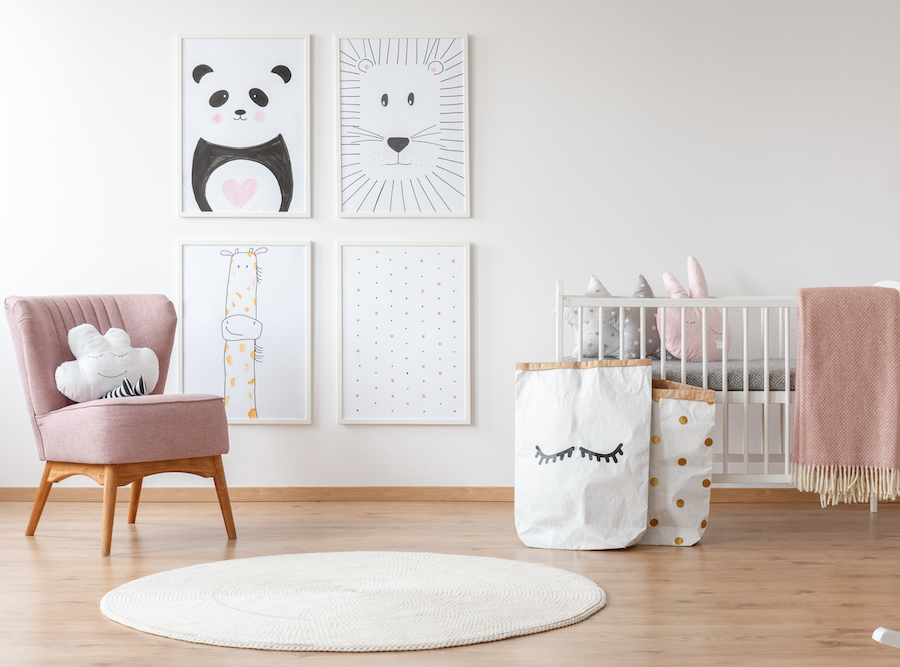 baby room with wall art and pink armchair