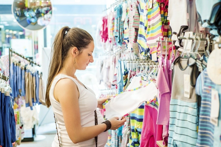Woman shopping for baby products in store