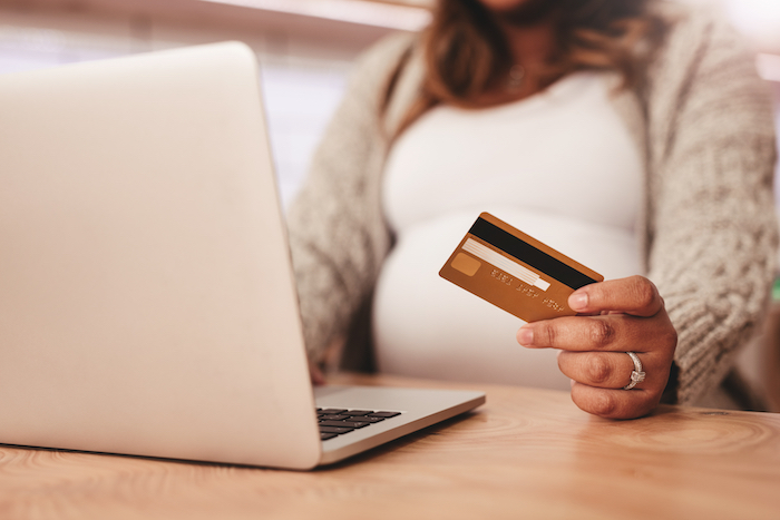Pregnant woman shopping off her Amazon registry using completion discount