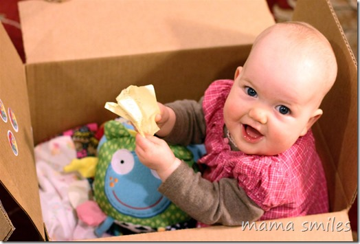 baby playing in cardboard box