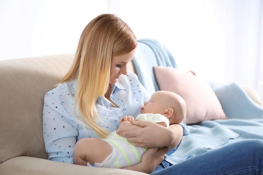 baby asleep in mom's arms before sleep training