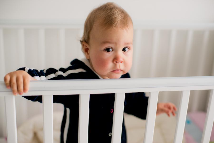 Baby standing in crib during sleep training