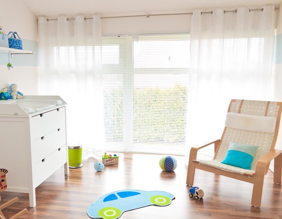 Chair in baby's nursery to sleep train using the Sleep Lady Shuffle