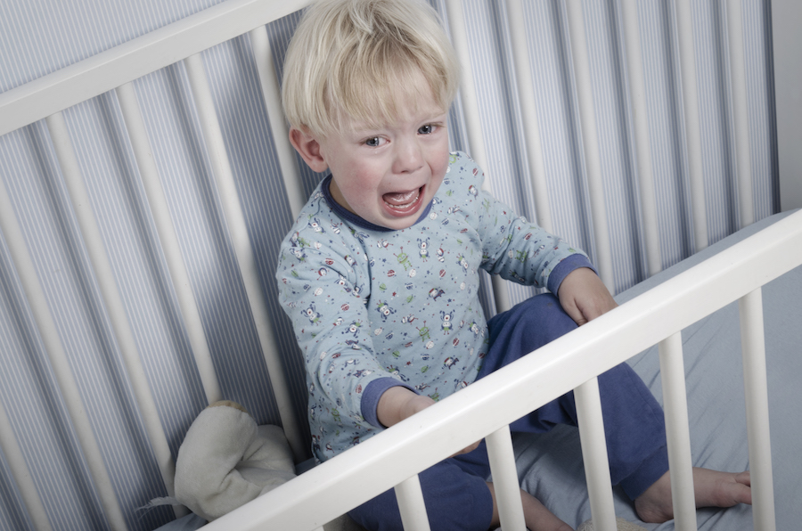 2 year old crying in his crib during common two year sleep regression
