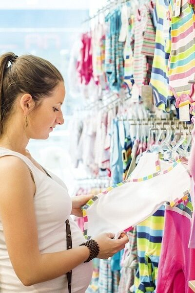 what not to put on baby registry - pregnant woman shopping
