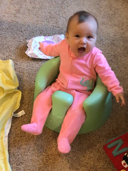 baby sitting in a Bumbo - what not to put on baby registry