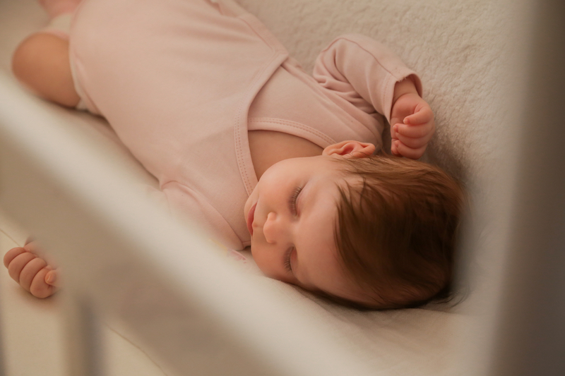 baby sleeping in crib after transitioning to 2 naps