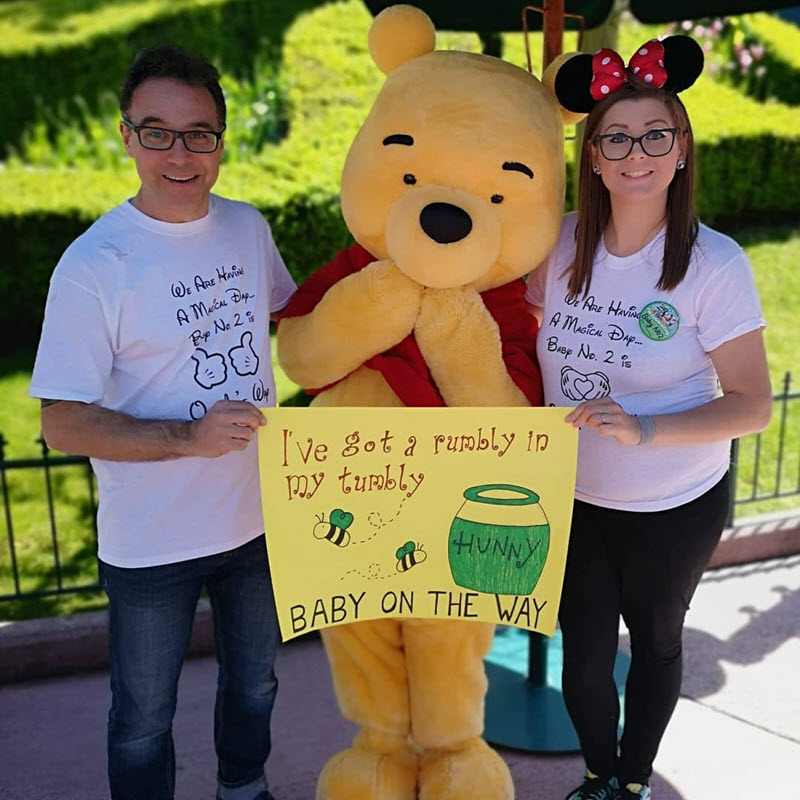 Disney pregnancy announcement - couple with Pooh Bear announcing a rumbly in my tummy