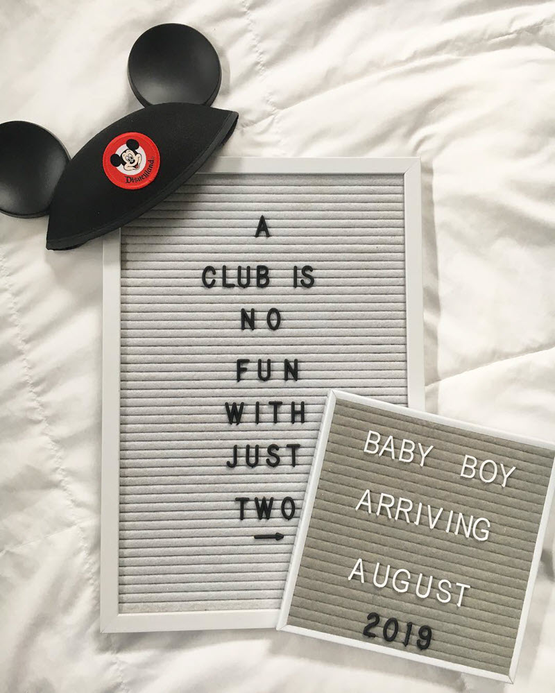 Disney pregnancy announcement - Mickey ears and letterboards announcing baby boy