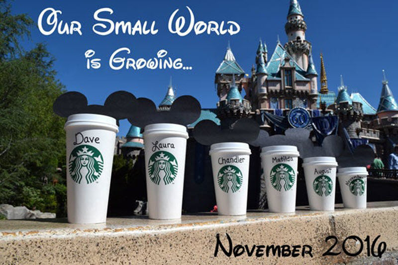 Disney pregnancy announcement - family names on Starbucks coffee cups in front of Disney castle