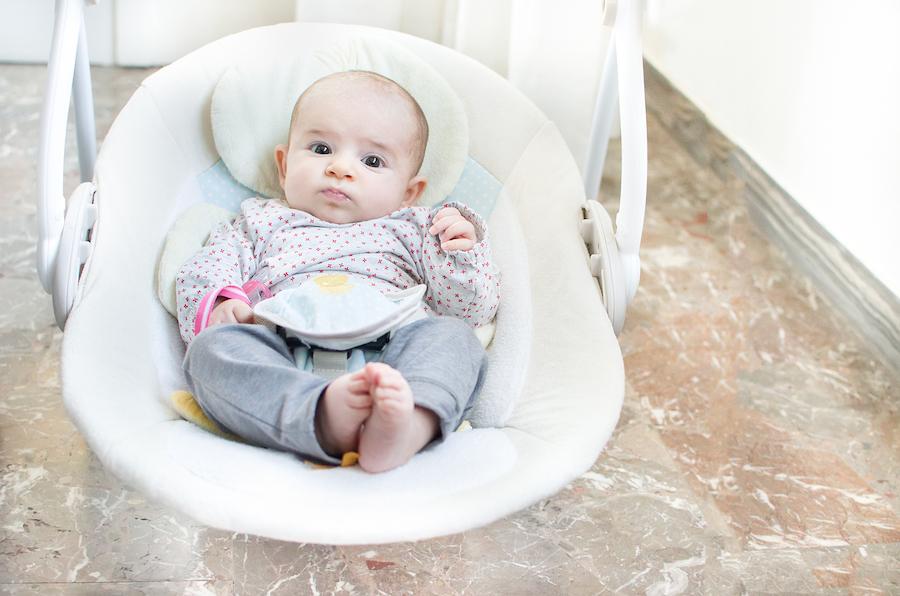 baby awake in swing ready to drop third nap