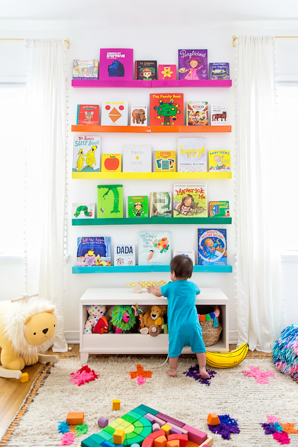 rainbow bookshelves in nursery