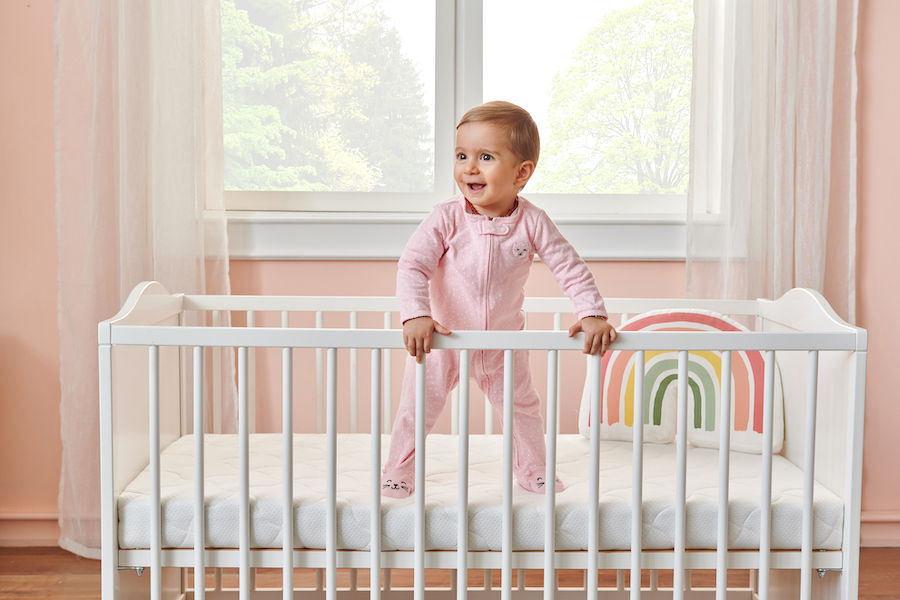 baby getting close to climbing out of crib
