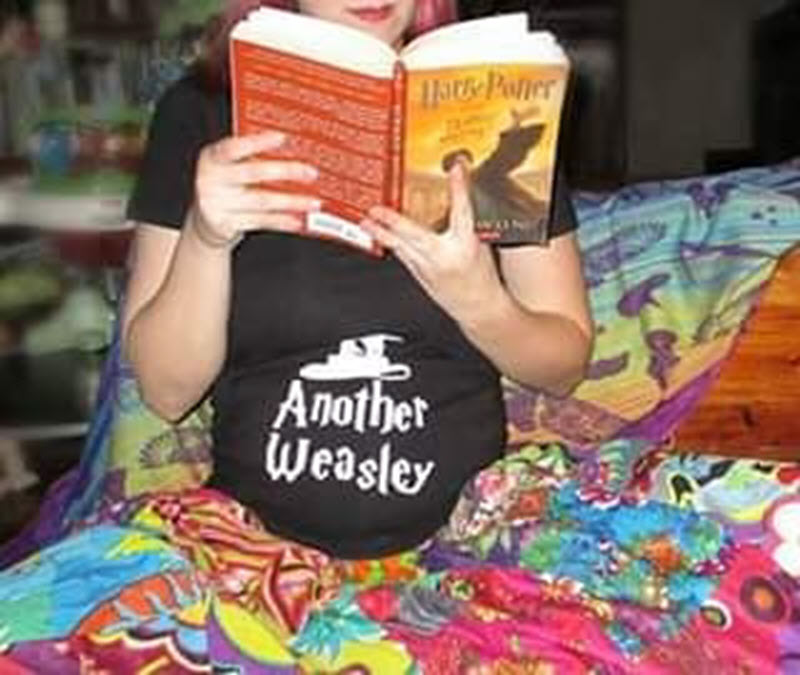 new mom reading Harry Potter book to announce pregnancy