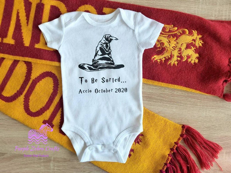 Harry Potter onesie announcing new baby