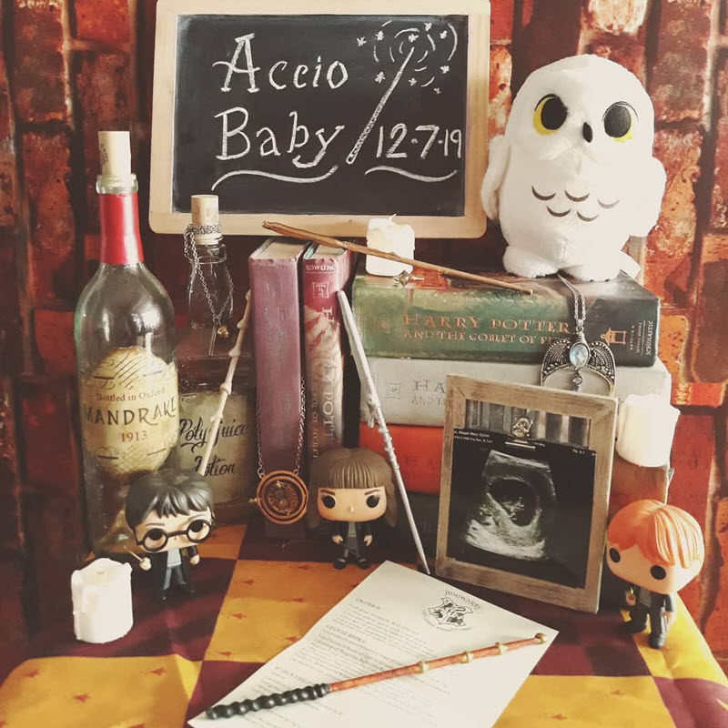 Harry Potter pregnancy reveal with Hedwig, books, and ultrasound photo