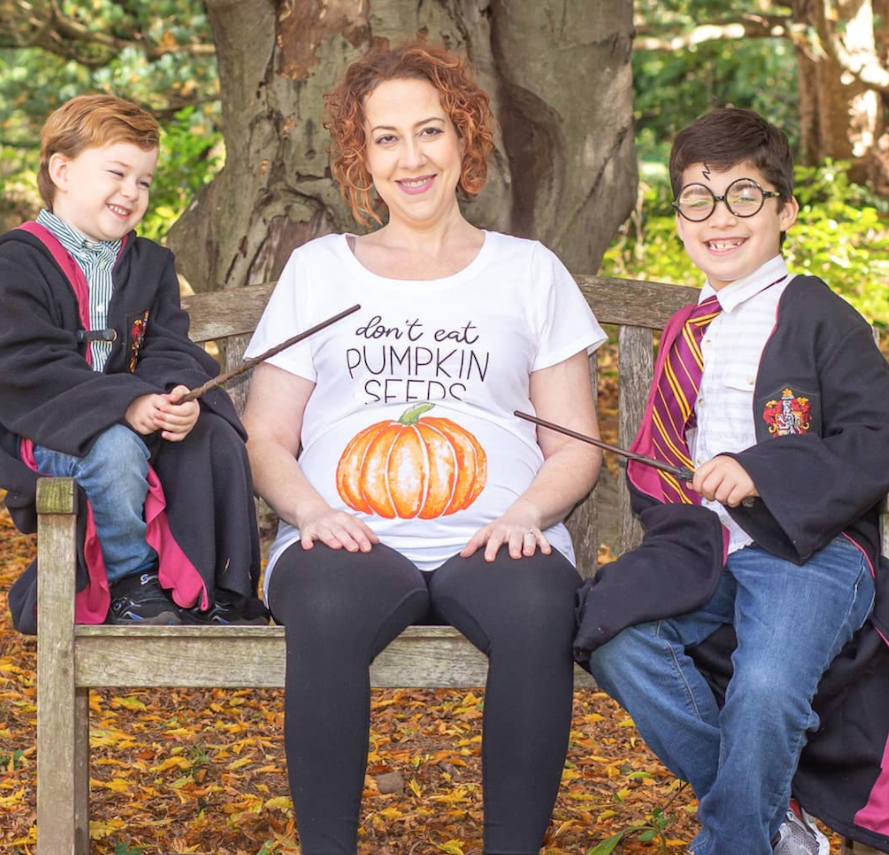 Pregnant mom and brothers doing a Harry Potter inspired pregnancy reveal
