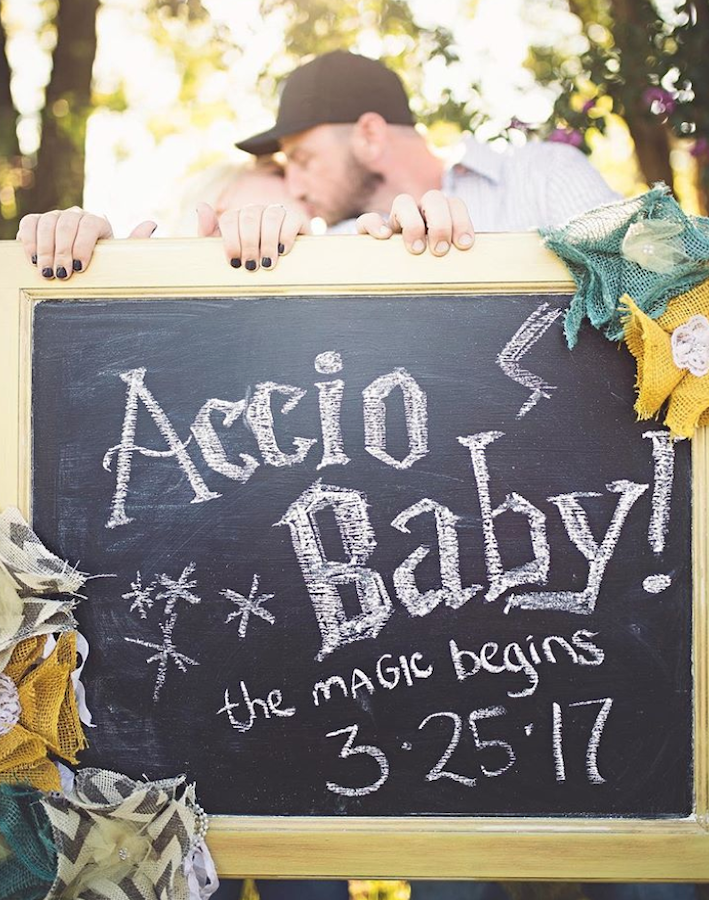 Accio Baby Harry Potter pregnancy announcement with parents holding sign
