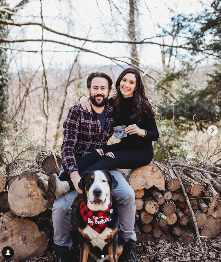 couple and dog announcing pregnancy with ultrasound photo