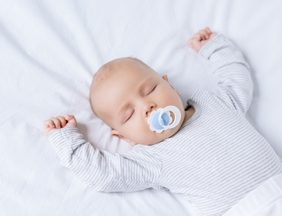 baby sleeping on back with pacifier