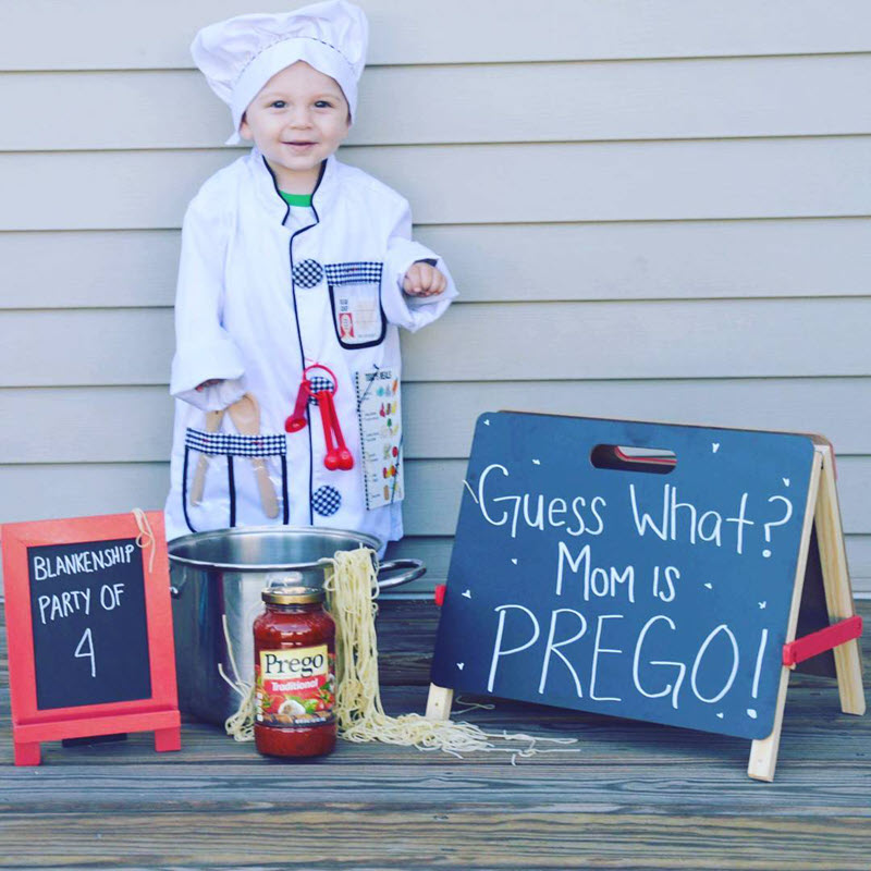 funny pregnancy announcement photo with kid chef