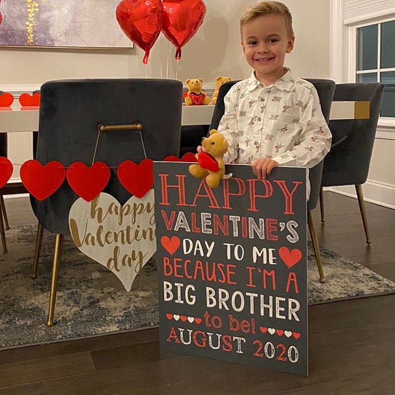 big brother chalkboard pregnancy announcement on Valentine's Day