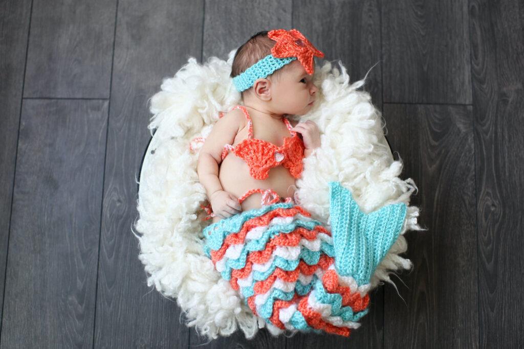 newborn baby dressed in Mermaid costume - when to take newborn photos