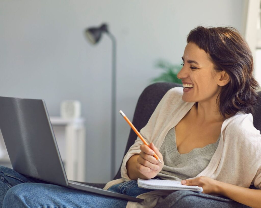 woman laughing with laptop