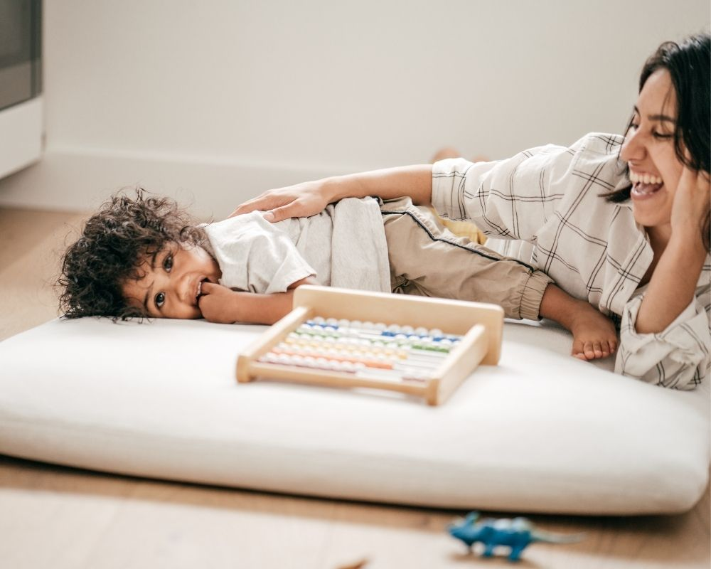 toddler playing with mom before bedtime
