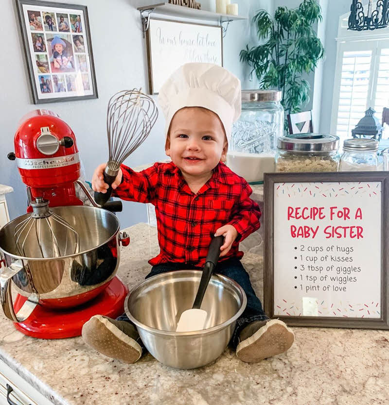 big brother holding whisk and bowl announcement  - recipe for baby sister
