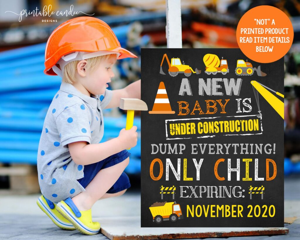 little boy holding only child expiring construction sign
