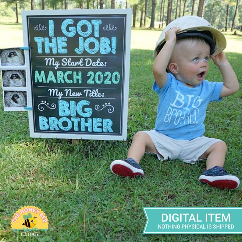 baby boy with promoted to big brother sign