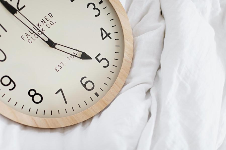 clock on bed - baby wake windows