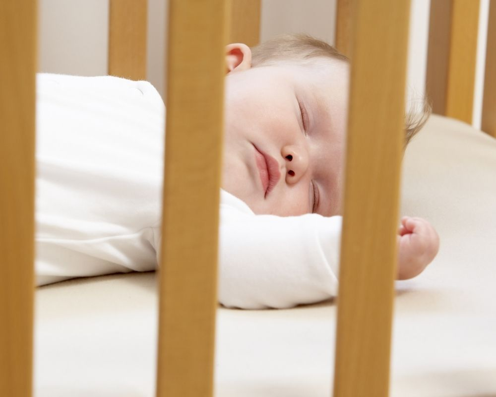 new baby sleeping in crib