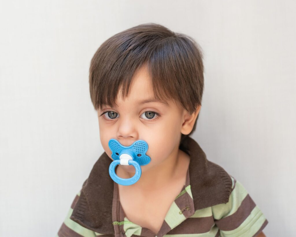 older toddler using a pacifier
