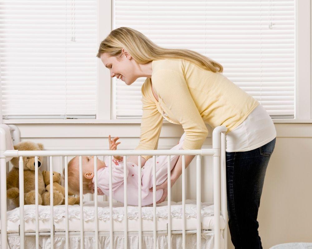 lowering crib mattress - mom and baby