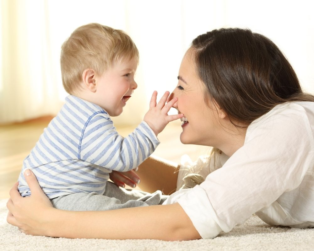 mom and baby playing during activity of EASY baby schedule
