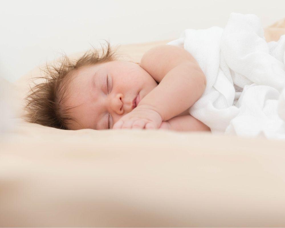 baby sleeping on a newborn lounger