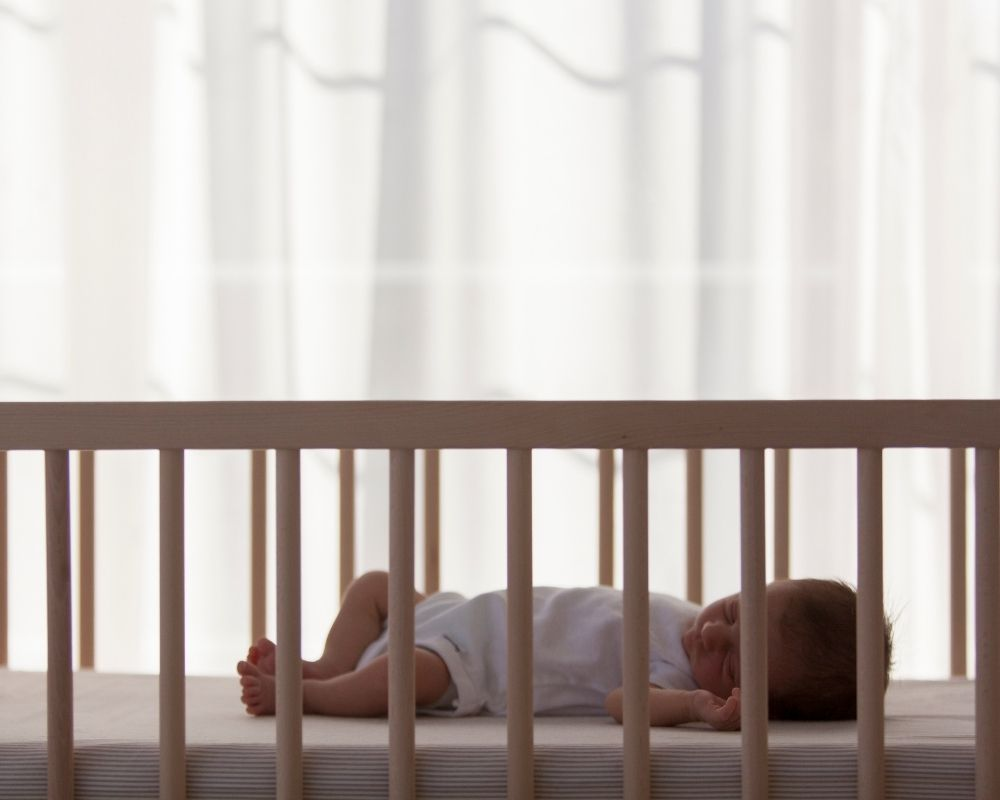 dockatot safety - baby sleeping in a crib is the safest sleep space