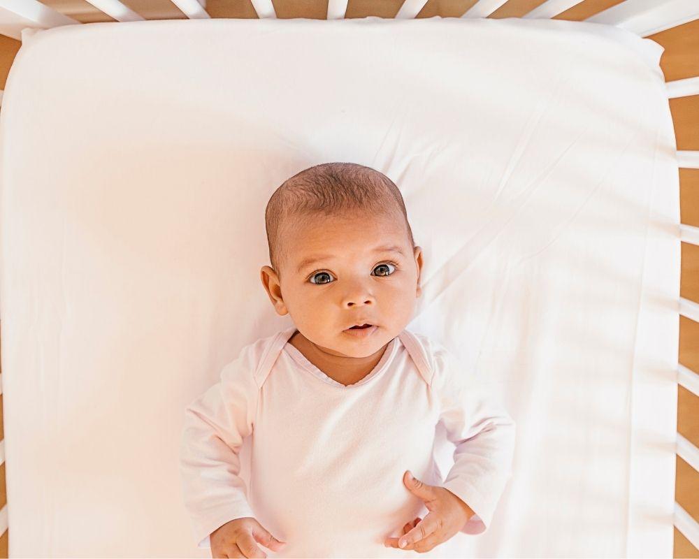 baby awake in crib