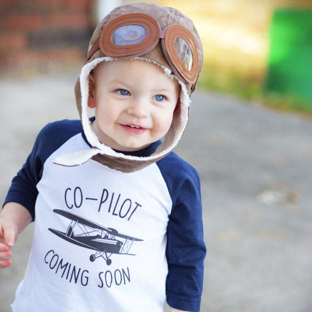 baby boy wearing co-pilot shirt and hat